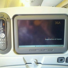 Photo taken at ANA Flight 7 by Lijie R. on 3/23/2012