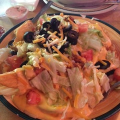 Photo taken at Macados Restaurant & Bar by Lyndsay G. on 5/5/2012