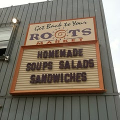 Photo taken at Roots Market by Mickey F. on 3/21/2012