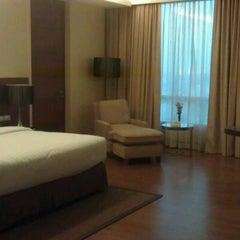 Photo taken at The Grand FourWings Convention Hotel (โรมแรมเดอะแกรนด์โฟร์วิงส์) by SookPeng L. on 12/12/2011