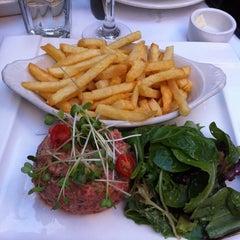 Photo taken at Cafe Bastille by Arnaud M. on 5/5/2011