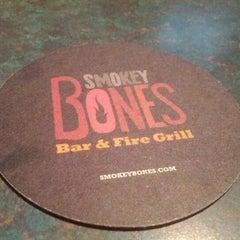 Photo taken at Smokey Bones Bar & Fire Grill by Stephan Z. on 5/12/2012