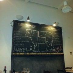 Photo taken at Maxela by Gioia V. on 3/9/2012