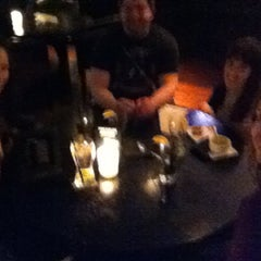 Photo taken at The Office Restaurant & Lounge by Trevor B. on 3/1/2012