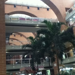 Photo taken at C.C. Plaza Las Américas by Marianna D. on 3/21/2012