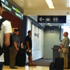 Photo taken at Gate F7A by Andrea Robyn G. on 7/31/2012