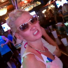 Photo taken at Dicey Riley's Irish Pub Bar by Roland D. on 7/21/2012