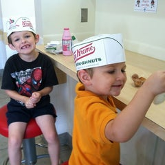 Photo taken at Krispy Kreme Doughnuts by Eileen S. on 8/6/2012