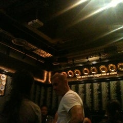 Photo taken at Flying Saucer Draught Emporium by Kyle M. on 7/29/2012