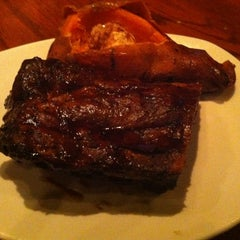 Photo taken at Outback Steakhouse by Kendra K. on 7/15/2012