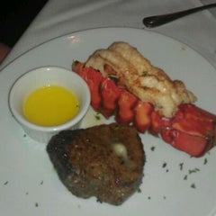 Photo taken at Fleming's Prime Steakhouse & Wine Bar by Vichearo L. on 4/3/2012
