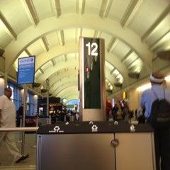 Photo taken at Gate 12 by Jordan on 7/9/2012