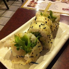 Photo taken at Tomo Sushi by Amy E. on 8/4/2011
