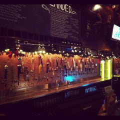 Photo taken at Flying Saucer Draught Emporium by Sarah W. on 12/30/2011