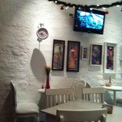 Photo taken at Café des Fleurs by Naira F. on 12/9/2011