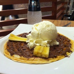 Photo taken at Crepes & Waffles by Paula M. on 1/29/2012
