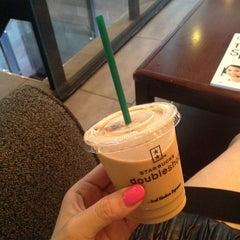 Photo taken at Starbucks by jennifer y. on 6/17/2012