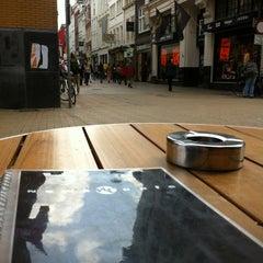 Photo taken at News Café by Leonie W. on 6/7/2012