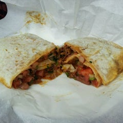 Photo taken at Yuca's Taqueria by Andrew K. on 11/19/2011