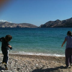 Photo taken at Baška Beach by Sanja A. on 4/21/2012