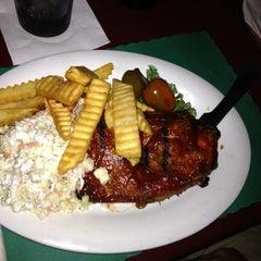 Photo taken at Guppy's Tavern by Tiffany C. on 7/26/2012