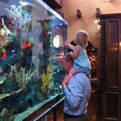 Photo taken at Milagros by Christi W. on 6/10/2012