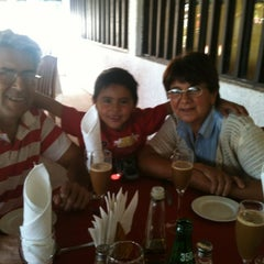 Photo taken at Los Pimientos De Auco Restaurant by Lorena C. on 4/22/2012