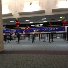 Photo taken at Southwest Airlines Ticket Counter by Javier F. on 2/14/2012