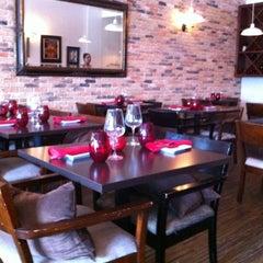 Photo taken at Saffron Indian Cuisine by Dhiren S. on 8/5/2012