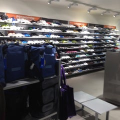 Photo taken at Adidas outlet store by Carlos M. on 3/18/2012