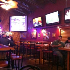 Photo taken at Ron Dao's Pizzaria & Sports Bar by Lauren W. on 12/29/2010