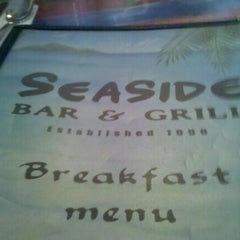 Photo taken at Seaside Bar and Grill by Adela W. on 9/4/2011