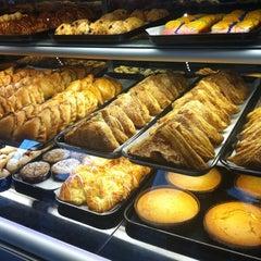 Photo taken at Porto's Bakery & Cafe by Josie G. on 8/19/2011