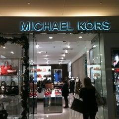 Photo taken at Michael Kors by Rebecca B. on 12/16/2011