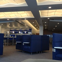 Photo taken at Delta Sky Club by John C. on 3/17/2012