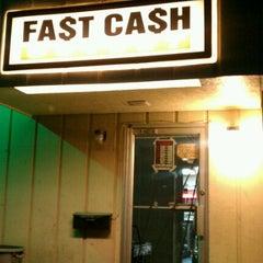 Photo taken at Fast Cash Pawn Shop by Nena M. on 1/10/2012