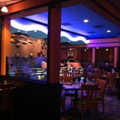 Photo taken at Blue Pacific Sushi & Grill by Bri L. on 1/2/2012