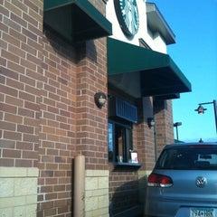 Photo taken at Starbucks by lucina m. on 7/27/2012
