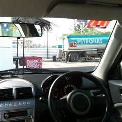 Photo taken at Petronas by Ira A. on 6/6/2012