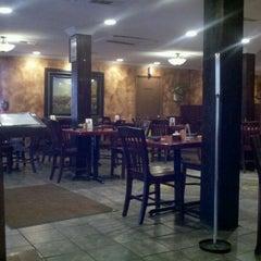 Photo taken at Aladdin Mediterranean Grill by Emma L. on 7/13/2012