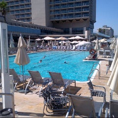 Photo taken at Hilton Pool by Marcus K. on 7/3/2012