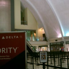 Photo taken at Delta Air Lines Ticket Counter by Brandon T. on 11/27/2011