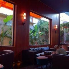 Photo taken at Río Café by Adam K. on 12/20/2011