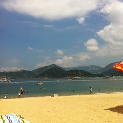 Photo taken at South Bay Beach 南灣泳灘 by Steph N. on 7/24/2011