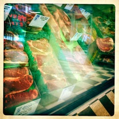 Photo taken at Oliver's Meat Market by Michael N. on 5/3/2012