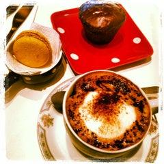Photo taken at Café des Fleurs by Daniela B. on 8/30/2012