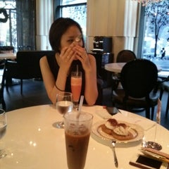 Photo taken at Café de JURA by Joon Pil Y. on 8/5/2012