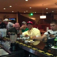 Photo taken at Sporting News Bar & Grill by Liz F. on 1/4/2012