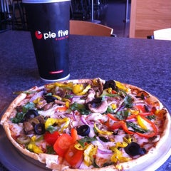 Photo taken at Pie Five Pizza Co. by Ty L. on 7/19/2012