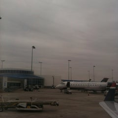 Photo taken at Gate E5 by Cara G. on 2/6/2012